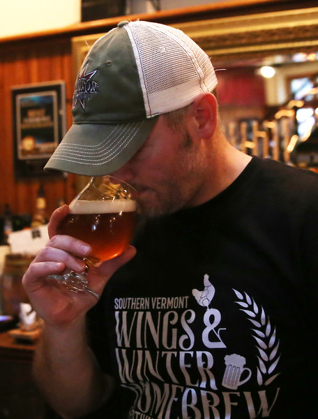 HOLLY PELCZYNSKI - BENNINGTON BANNER William Gardner, brewery manager at Madison Brewing Company Pub & Restaurant inhales the aroma of a brute style beer on Thursday in Bennington.