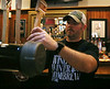HOLLY PELCZYNSKI - BENNINGTON BANNER William Gardner, brewary manager at Madison's Brewing Company Pub & Restaurant pours a beer for a customer on Thursday at the restaurant.