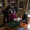 Sara Bogosian and Ambassador James Costos look through a Whistler book in the residence office