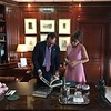 Ambassador James Costos and Sara Bogosian look at Whistler books in the Ambassador's office a the embassy.