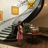 Sara Bogosian in front of spiral staircase in the U.S. Embassy residence. Josef Albers paintings hang on the wall.