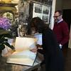 Ambassador James Costos with Sara Bogosian signing the official guest book