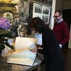 Ambassador James Costos with Sara Bogosian signing the official guest book