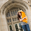 Mae Brooks holding UT Confirmation Day flag in front of Ayres Hall - Photo by Kellie Crye Ward
