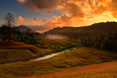 Sunrise over mountain range at Pang-Ung