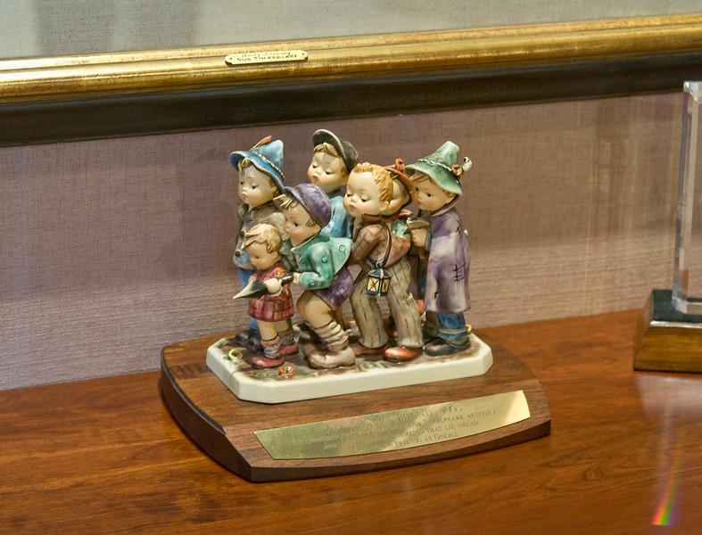 Bob Timberlake's seven grandchildren are represented in a Hummel figurine.
