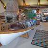 A canoe holds prints for sale at the gallery.