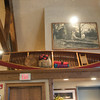 The gallery is literally filled to the rafters with interesting things to look at. Above this canoe is a photo of Bob with Iron Eyes Cody.