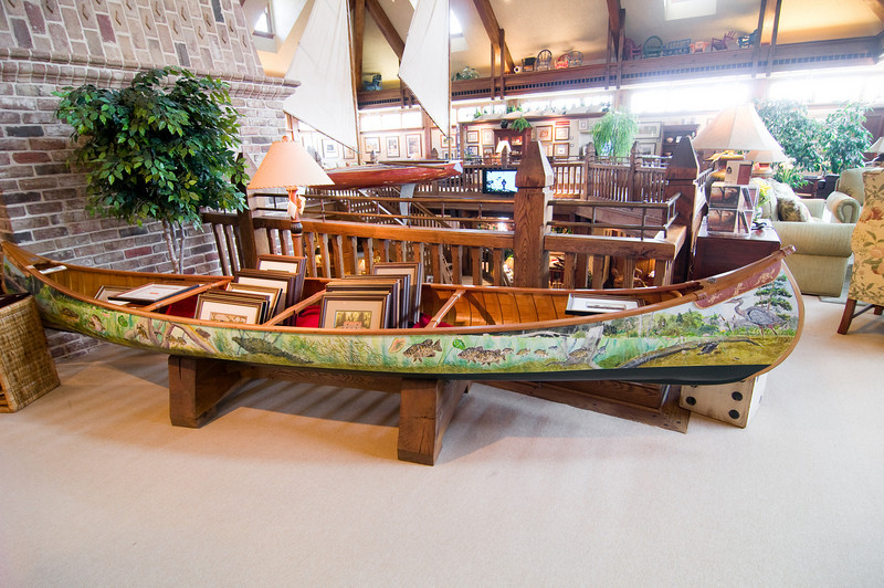 A brightly painted canoe holds prints for sale at the gallery.