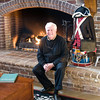 Bob sitting by the fire at the Lexington Gallery.
