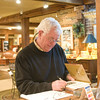 Bob signs cookbooks.