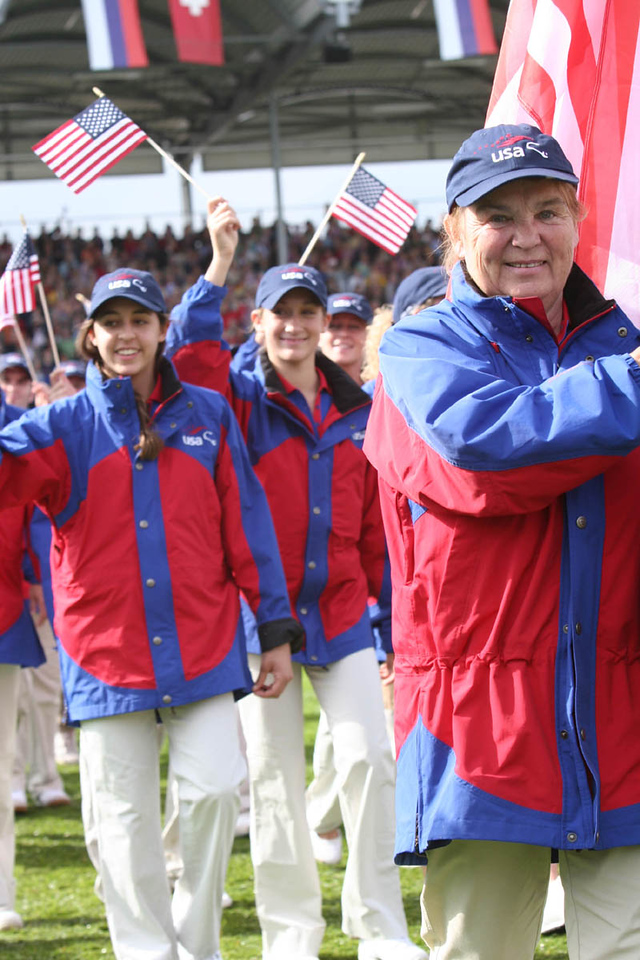 #1 Kathy Downs carries US Flag in Opening Walk of Nations