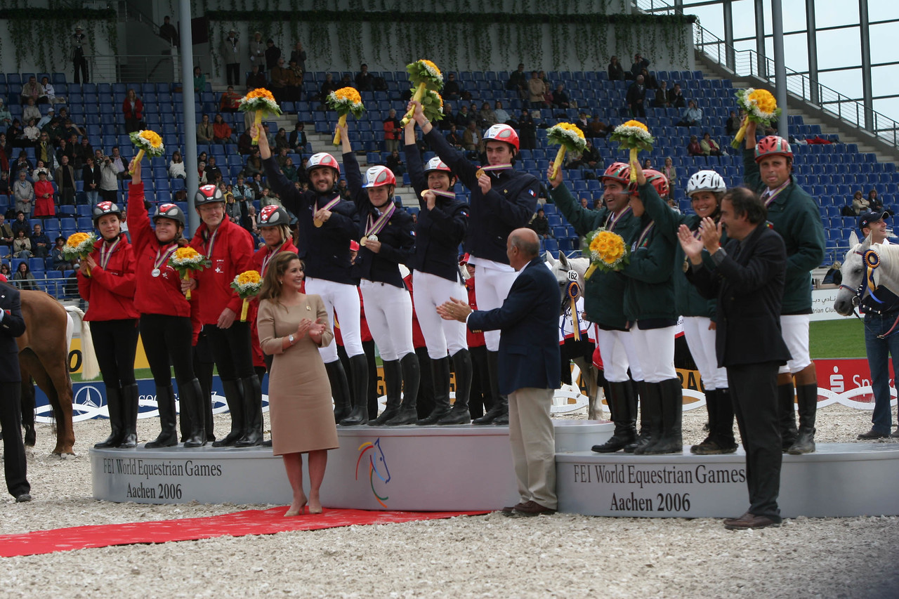 #37-French Gold medal riders receive flowers -Princess Haya and Jean-Louis Leclerc (French National Trainer)