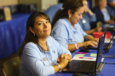 Malisa Espinal (Member Services, Call Center) waits to register members at the 2015 Annual Meeting in Giddings, Tx.