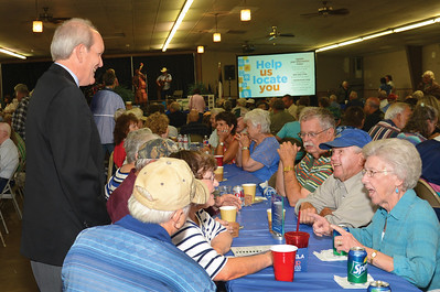 Mark Rose, General Manager visits with members during the 2015 Annual Meeting in Giddings, Texas.
