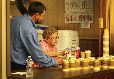 Paul Herzog helps a member carry her refreshments at the 2015 Annual Meeting in Giddings, Tx.