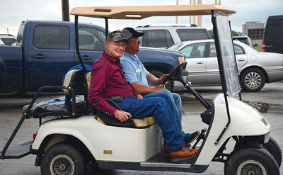Steven Medack drives a member to the front door of the Sons of Herman Hall in Giddings, Tx.