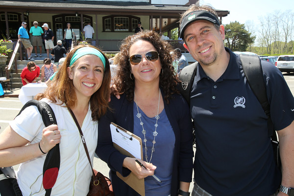 KEN YUSZKUS/Staff photo.       From left, Jennifer Stevenson, Adriane Cioffi who is the daughter of John Aucone, and Jeff Stevenson, all of Beverly, attend the John Aucone Memorial Golf Tournament.  John Aucone  was a long-time teacher, Beverly High assistant principal; Briscoe MS principal; Hall of Fame soccer coach at both Salem High and St. John's Prep, who died last year. Jennifer and Jeff used to be neighbors of John Aucone.    05/23/16