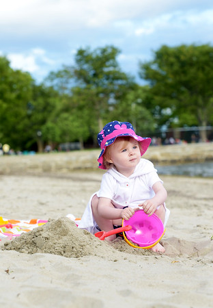 JIM VAIKNORAS/Staff photo Lucy Lovett, 2, of Beverly spends a sunny day at the beach at Lynch Park.