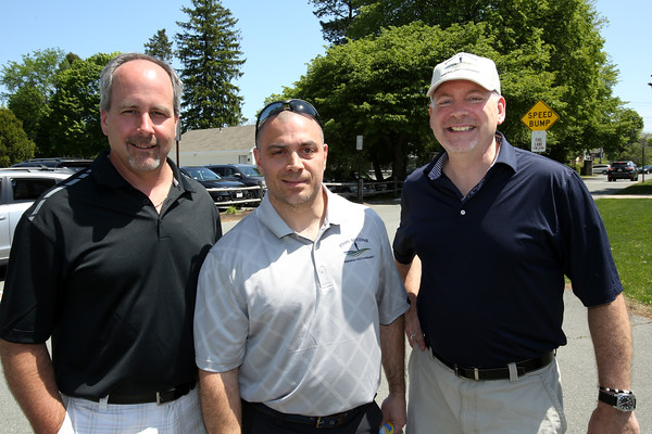KEN YUSZKUS/Staff photo.       From left, Joe Marshall, Tony Cioffi, and Tim Murray, all of Beverly, attend the John Aucone Memorial Golf Tournament.  John Aucone  was a long-time teacher, Beverly High assistant principal; Briscoe MS principal; Hall of Fame soccer coach at both Salem High and St. John's Prep, who died last year.      05/23/16