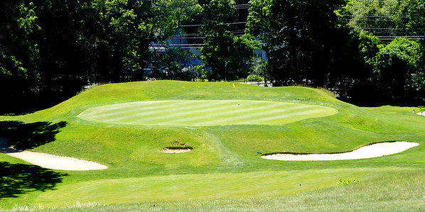JIM VAIKNORAS/Staff photo The 15th hole at Beverly Golf and Tennis. A 163 yard par 3, named The Wedding Cake.