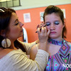 HADLEY GREEN/ Staff photo<br /> Ashley Springett, a dance teacher at Mitchell's Dance Studio, does dancer Maggie Skelly's eye makeup before the studio's recital. The Beverly dance studio is celebrating 85 years. 5/20/17