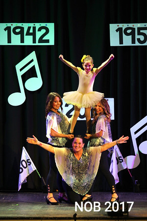 """Sisters Theresa Vasile, standing left,  and Caroline Vasile Rousseau, right, dance with their daughters Nina Rousseau, in yellow dress, and Rebecca Dunlop to the song """"You are my Sunshine""""  at the Mitchell's Dance Studio 85th anniversary show. The show was held at Briscoe Middle School Beverly on May 20, 2017. The Vasile sisters have been dancing at the studio since they were children."""