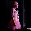 HADLEY GREEN/ Staff photo<br /> Kalyn Elario, who's mother, Monique Elario, teaches ballet at Mitchell's Dance Studio, watches dancers from backstage during the annual recital. 5/20/17