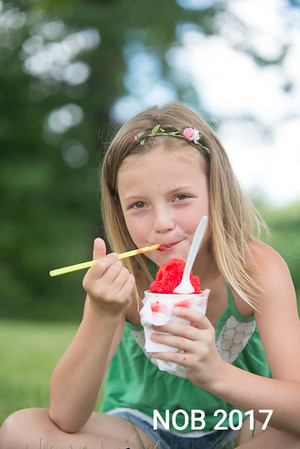JIM VAIKNORAS/Staff photo Ruby McCay, 6, of Beverly enjoys a watermelon Snoball on a warm afternoon. Ruby will be entering is a student at the Centerville School in Beverly