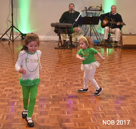 JIM VAIKNORAS/Staff photo Ivana Taylor ,3, and her sister Bianca, 2, dance to the music of Tobin and Leahey at the St Patrick's Day dinner at the Hastings House in Beverly Farms.