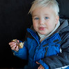 JIM VAIKNORAS/Staff photo peter Kneisel, 2, of Manchester by the Sea, enjoys a chocolate glazed donut at Half Baked in Beverly.