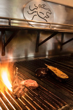 Lamb chops and eggplant on the wood fire grill at the Wild Horse Cafe.<br /> Photo by Don Toothaker