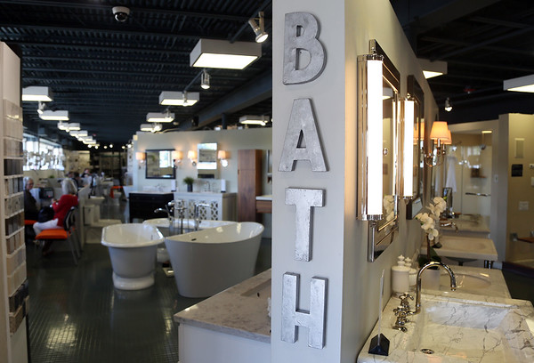 DAVID LE/Staff photo. The showroom at Designer Bath and Salem Plumbing Supply in Beverly.