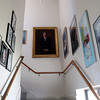 DAVID LE/Staff photo. The staircase leading up to offices in Salem Light and Design in Beverly is filled with old staff photos.