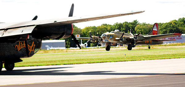 JIM VAIKNORAS/Staff photo A B 17 Flying Fortress taxis in under the wing of a B 24 Liberator during the Collins Foundation Wings of Victory Tour at Beverly Airport.