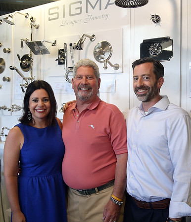 DAVID LE/Staff photo. Ralph Sevinor, with his children, Jason, current president, and Mindy, of Designer Bath and Salem Plumbing Supply. The business is celebrating its 70 years of business.