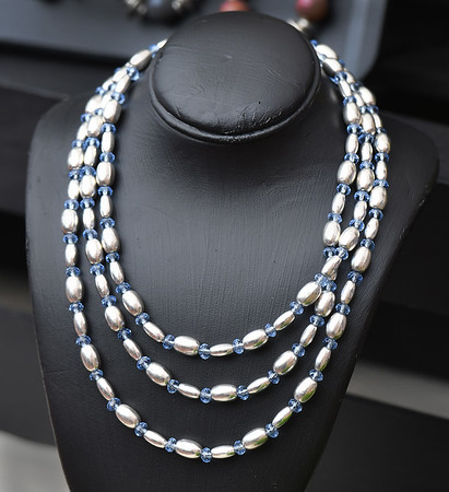 A multi level bead necklace offered by North Shore ARC at the Salem Farmers Market. <br /> <br /> Photo by JoeBrownPhotos.com