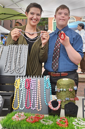 Elise Snow and Michael Thibedeau Jr. of Beverly, 24 display the jewelry created as part of the North Shore Arc and sold at the Salem Farmer's Market.<br /> <br /> Photo by JoeBrownPhotos.com