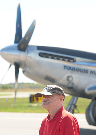 JIM VAIKNORAS/Staff photo Robert Jenson of Danvers poses with the P-51 Mustang at the Collins Foundation Wings of Victory Tour at Beverly Airport.