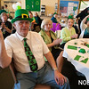 AMY SWEENEY/Staff photo. Richard Oliver dressed in his Irish finest sings during the sing-along with Brian Corcoran at the Beverly Senior Center St. Patrick's Day Party.