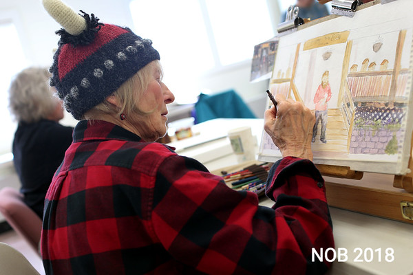 HADLEY GREEN/Staff photo<br /> Marci Smallman of Wenham paints at a watercolors class at the Beverly Council on Aging. <br /> <br /> 03/12/18