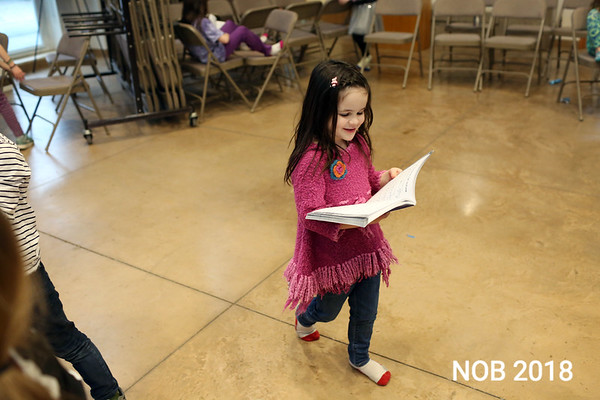 HADLEY GREEN/Staff photo<br /> Simonne Stern, a five-year-old preschool student from Marblehead, reads her Mary Poppins script during rehearsal at the Glen Urquhart School in Beverly. <br /> <br /> 03/06/18