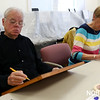 HADLEY GREEN/Staff photo<br /> Paul Knox and Mary Anne Baker sketch before painting at a watercolors class at the Beverly Council on Aging. <br /> <br /> 03/12/18