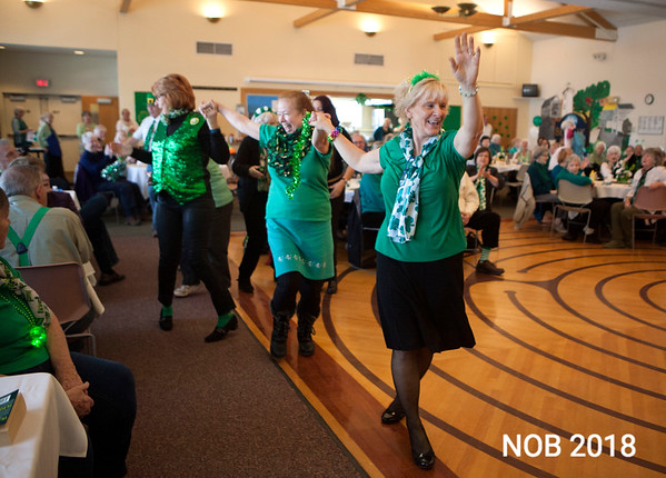 AMY SWEENEY/Staff photo. Patti Rice, activities co-ordinator at the Beverly Senior Center, leads a conga line followed by Carol Matthew and Marion Devir during the St. Patrick's Day party on March 15.