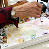 HADLEY GREEN/Staff photo<br /> Marci Smallman of Wenham mixes her colors at a watercolors class at the Beverly Council on Aging. <br /> <br /> 03/12/18