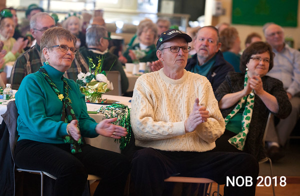 """AMY SWEENEY/Staff photo. Cookie and Barry Fritz, left, and Gloria Popiedzinski, sing along to """"God Bless America"""" with Brian Corcoran during the St. Partrick's Day party held at the Beverly Senior Center.<br /> 3/15/2018"""