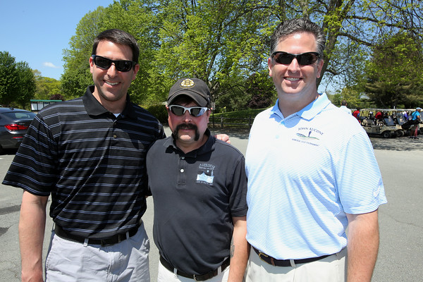 KEN YUSZKUS/Staff photo.       From left, Dave Margolis of Wakefield, Karl Lemieux of Marblehead, and Geoff Bessin of Rockport attend the John Aucone Memorial Golf Tournament.  John Aucone  was a long-time teacher, Beverly High assistant principal; Briscoe MS principal; Hall of Fame soccer coach at both Salem High and St. John's Prep, who died last year.      05/23/16