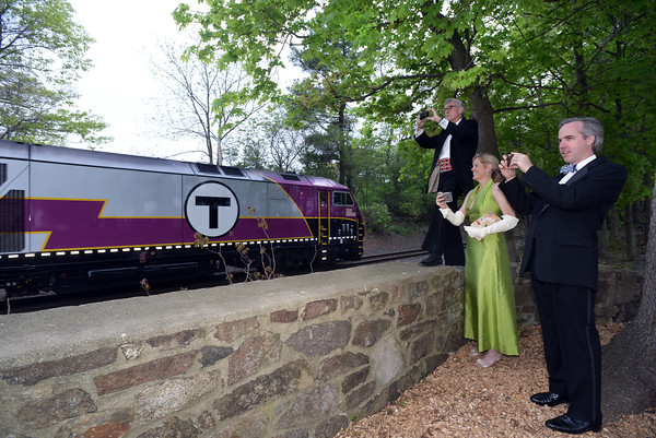 CARL RUSSO Staff photo. BEVERLY MAG. People attending the gala take pictures as the train from Boston arrives with more guest attending the gala. The Trustees' 125th Anniversary Gala, held at Appleton Farms in Ipswich, celebrated The Trustees' rich history as the world's first land preservation organization and pay tribute to the generations of leaders and generous supporters who have helped to save and care for The Trustees' inspired places. Founded in 1891 by landscape architect Charles Eliot, The Trustees today is Massachusetts' largest conservation and preservation organization with 116 scenic, natural, cultural and agricultural properties spanning over 27,000 acres around the Commonwealth, all open to the public.5/21/2016