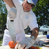 Beverly:<br /> Steve Harvey cuts into one of the many lobsters which he is preparing at the annual Beverly Homecoming Lobster Festival held at Lynch Park.<br /> Photo by Ken Yuszkus, Salem News , Wednesday, August 7, 2013.