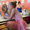 HADLEY GREEN/ Staff photo<br /> Dancer Kalyn Elario looks in the mirror while getting ready for Mitchell's Dance Studio recital. 5/20/17